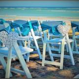 Small white wicker hearts, wedding chair decor.