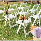 Fresh flower posies for wedding aisle decor.
