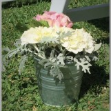 Buckets of fresh flowers.